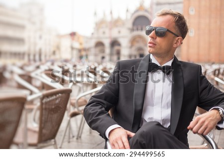 Portrait of handsome confident man in tuxedo - stock photo