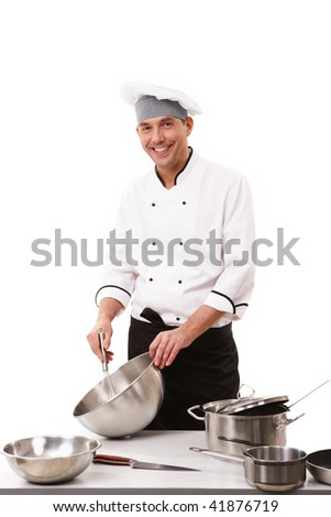 Portrait of handsome cook in uniform shaking something - stock photo