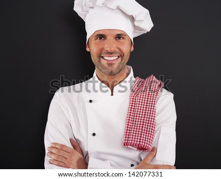 Portrait of handsome cooking chef - stock photo