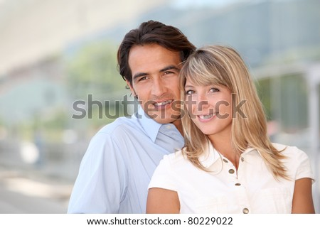 Portrait of handsome couple standing outside - stock photo