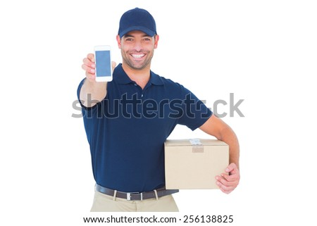 Portrait of handsome delivery man showing mobile phone on white background - stock photo