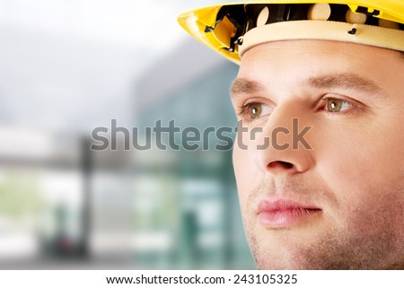 Portrait of handsome engineer in helmet - stock photo