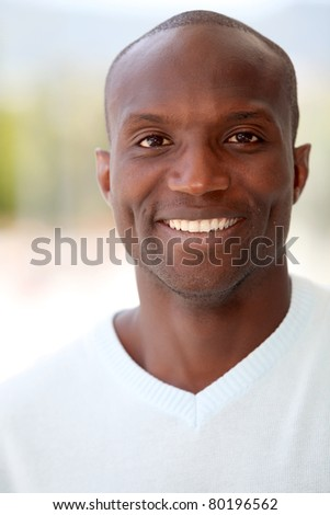 Portrait of handsome ethnic man - stock photo