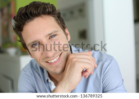 Portrait of handsome guy with blue shirt - stock photo