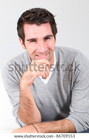 Portrait of handsome guy with hand on chin