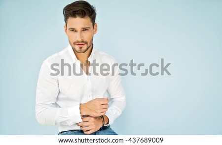 Portrait of handsome male model in white shirt - stock photo