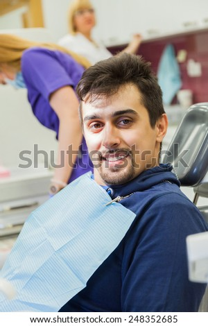 Portrait Of Handsome Male Patient Satisfied After Dental Examination