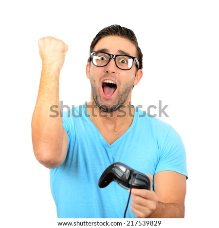 Portrait of handsome man holding joystick for video games against white background - stock photo