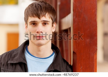 Portrait of handsome man in city. - stock photo
