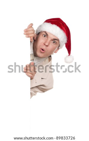 Portrait of handsome man in santa hat with blank billboard on white background - stock photo