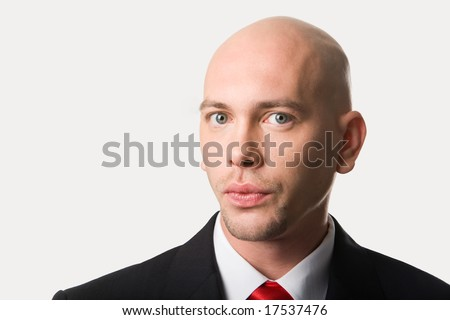Portrait of handsome man looking at camera - stock photo