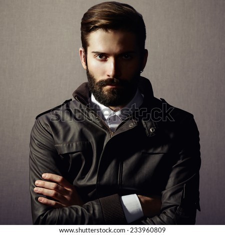 Portrait of handsome man with beard. Fashion photo - stock photo