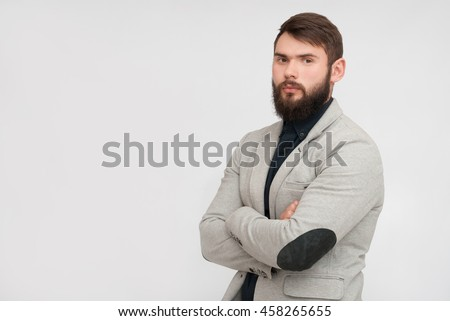 Portrait of handsome man with beard. Man in jacket with crossed hands