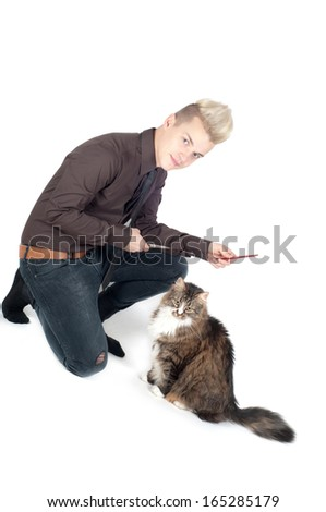 Portrait of handsome man with cat - stock photo