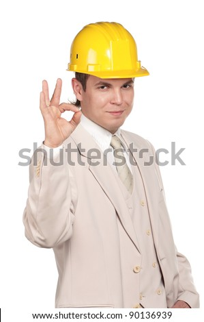 Portrait of handsome man with hard hat on white background