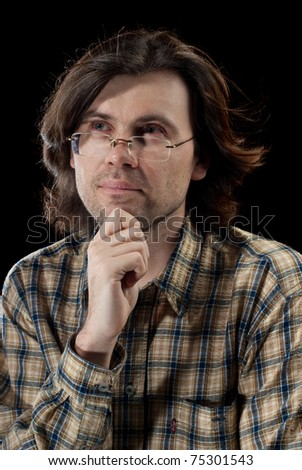 Portrait of handsome man with long hair. Isolated on black background. - stock photo