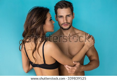 Portrait of handsome man with woman - stock photo