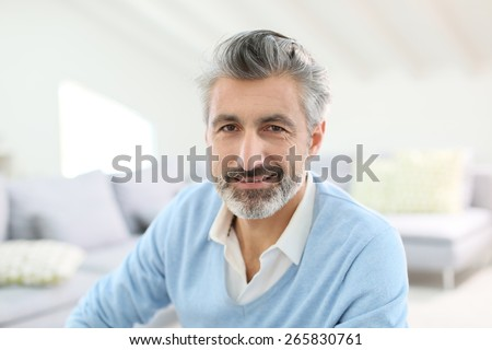 Portrait of handsome mature man with grey hair - stock photo