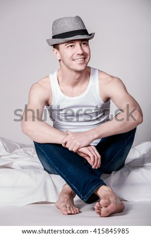 Portrait of handsome men sitting on the bed - stock photo