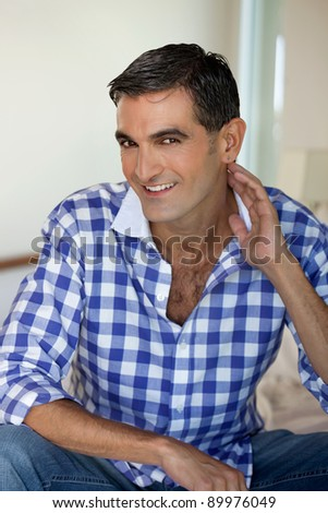 Portrait of handsome middle aged man smiling - stock photo