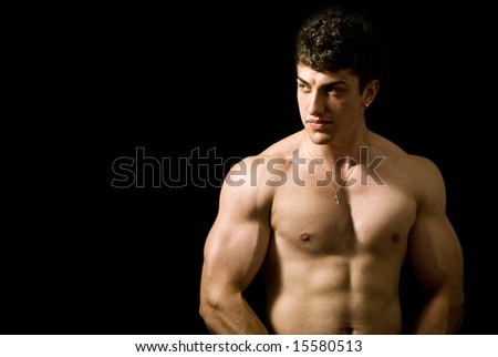 Portrait of handsome muscular man on black background - stock photo
