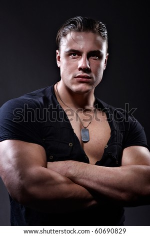 Portrait of handsome muscular young man - stock photo