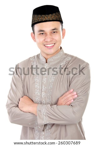 portrait of handsome muslim man smiling with arm crossed on white background - stock photo