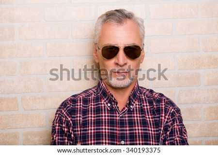 Portrait of handsome old man with sunglasses