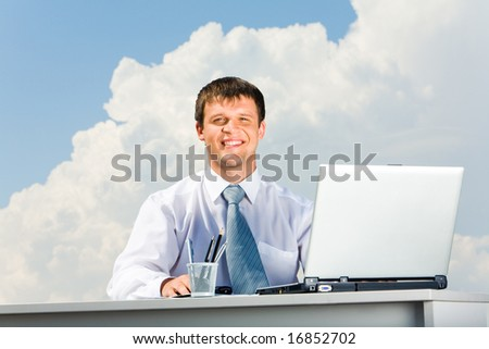 Portrait of handsome professional looking at camera on the background of sky