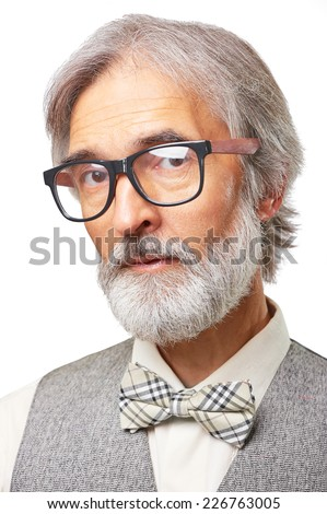 Portrait of handsome senior caucasian man with a gray beard, glasses and bowtie isolated on white background - stock photo
