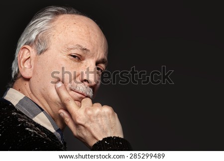 Portrait of handsome senior man with a tired expression on gray background with copy-space - stock photo