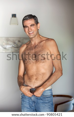 Portrait of handsome shirtless middle aged man smiling - stock photo