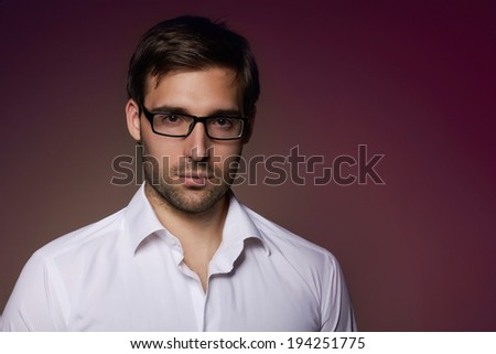 Portrait of handsome smart businesslike Financier or agent or manager in eyeglasses and white shirt
