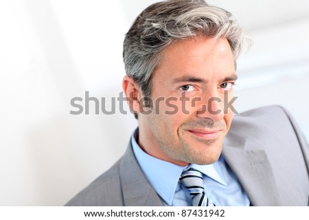 Portrait of handsome smiling businessman - stock photo