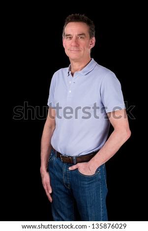 Portrait of Handsome Smiling Happy Middle Age Man Black Background - stock photo