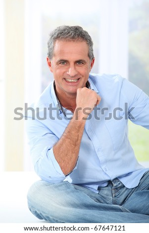 Portrait of handsome smiling mature man - stock photo