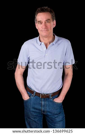 Portrait of Handsome Smiling Middle Age Man Hands in Pockets Black Background - stock photo