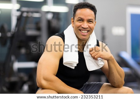 portrait of handsome sportive man in gym - stock photo