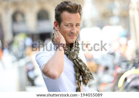 Portrait of handsome stylish guy in town - stock photo
