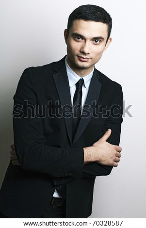 Portrait of handsome stylish man in business black suit