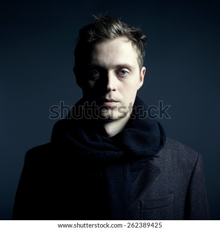 Portrait of handsome stylish man in coat - stock photo
