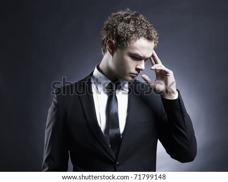 Portrait of handsome stylish man in elegant black suit - stock photo