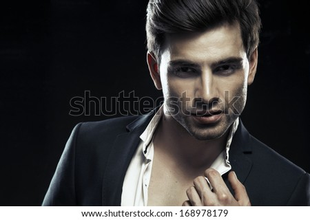Portrait of handsome stylish man in elegant suit  - stock photo