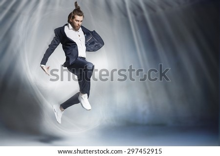 Portrait of  handsome stylish man jumping - stock photo