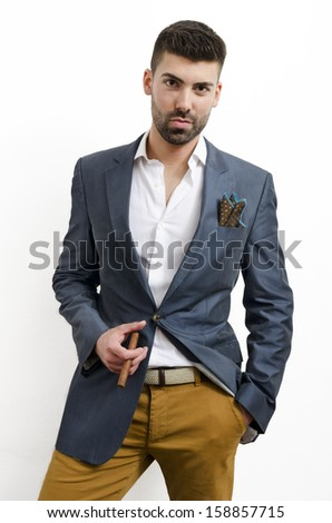 Portrait of handsome stylish man with cigar - stock photo