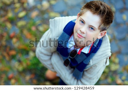 portrait of handsome teenage boy, top view - stock photo