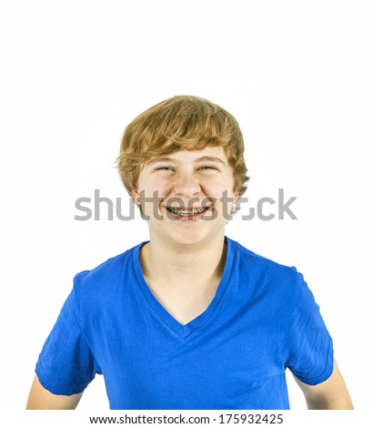 portrait of handsome teenage boy with blue shirt - stock photo