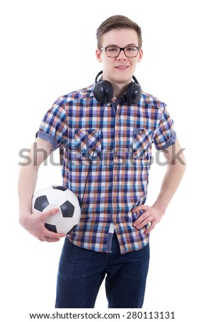 portrait of handsome teenage boy with headphones and soccer ball isolated on white background - stock photo