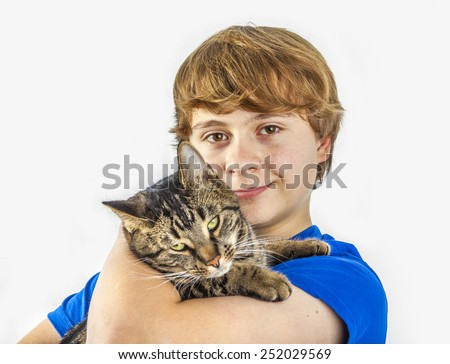portrait of handsome teenage boy with his cat - stock photo