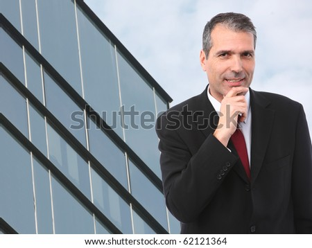 Portrait of handsome thoughtful businessman - stock photo